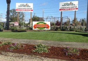 village nurseries sign