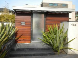 residential entry featuring Phormium tenax